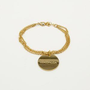 Bracciale Coconuda anallergico 23cm regolabile - multi catena oro- ciondolo color oro di forma tonda con incisione Coconuda. cobr2019