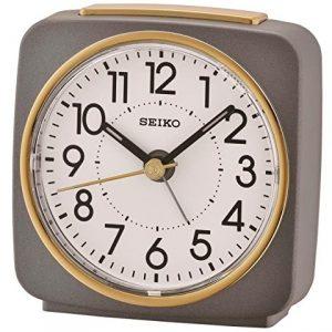 rologio Sveglia analogico plastica grigio e dorato movimento quarzoQuadrante bianco con lancette nero. Dotata di funzione allarme e luce, compreso di pila.