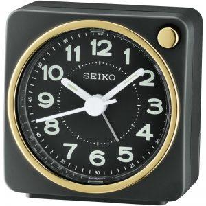 Orologio Sveglia analogico plastica nero e dorato movimento quarzo Quadrante nero con lancette bianche. Dotata di funzione allarme e luce, compreso di pila.