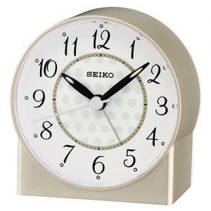 Orologio Sveglia analogico in plastica dorato con movimento al quarzo Quadrante bianco con lancette nereDotata di funzione allarme e luce, compreso di pila.