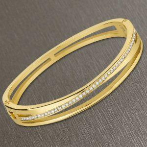 Bracciale da Donna a Marchio Lotus Style, con la referenza LS2113/2/2 Il nome della collezione a cui appartiene è Bliss. Bracciale rigido in acciaio di colore oro con zirconi, Spessore 2,80 mm - Chiusura a incastro.