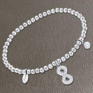 Bracciale da Donna a Marchio Lotus Style, con la referenza LS2170/2/6 Il nome della collezione a cui appartiene è Millennial, Bracciale elastico con sfere in acciaio - Spessore 4 mm, Pendente in acciaio infinito con strass.