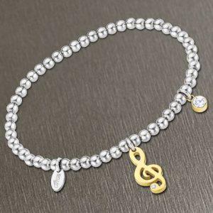 Bracciale da Donna a Marchio Lotus Style, con la referenza LS2171/2/5 Il nome della collezione a cui appartiene è Millennial, Bracciale elastico con sfere in acciaio - Spessore 4 mm, Pendente in acciaio dorato a chiave di violino con strass.