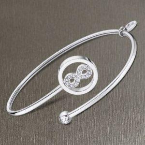 Bracciale da Donna a Marchio Lotus Style, con la referenza LS2169/2/4 Il nome della collezione a cui appartiene è Millennial, Bracciale rigido in acciaio, Con simbolo infinito e strass bianco.